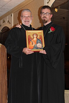 Father Jonathon Bannon presents gift from Christ the Savior Church, Rockford