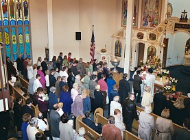 Faithful receive the Holy Eucharist (Communion)